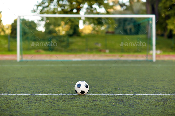 05373c071 soccer ball and goal on football field Stock Photo by dolgachov ...