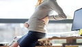 pregnant businesswoman sitting on table at office