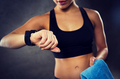 close up of woman with smartwatch and towel in gym