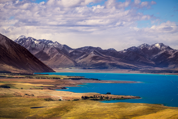 Landscape view of lakes and mountains, Lake Tekapo, New Zealand - Stock Photo - Images