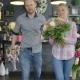 Couple Leaving Shop with Bouquet