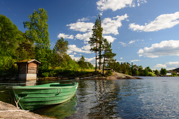 Green boat on a lake in a landscape in Norway - Stock Photo - Images