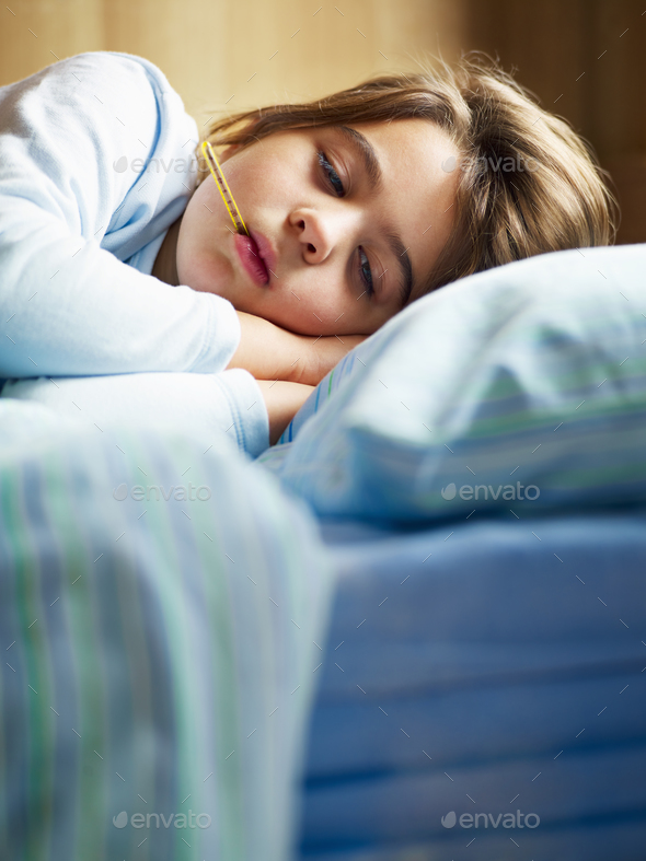 Young Girl Feeling Sick Measuring Fever With Thermometer - Stock Photo - Images