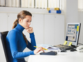 Female Young Secretary Using Calculator In Office - PhotoDune Item for Sale