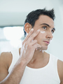 Young Handsome Man Applying Skin Cream On Face - PhotoDune Item for Sale