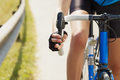Cropped View Of Female Cyclist Holding Break Of Bike - PhotoDune Item for Sale