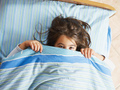 Shy Little Girl Looking At Camera Under Covers - PhotoDune Item for Sale