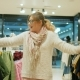 Crazy Girl Doing Shopping on Sale in Big Shopping Center, Female Shopaholic Buys Clothes in Store Nulled
