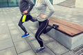 close up of couple doing lunge exercise on street