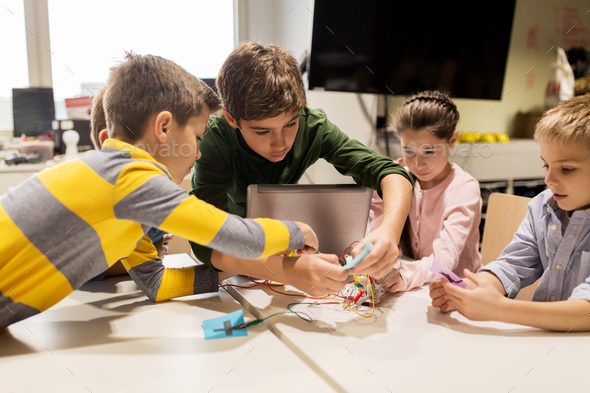 kids with invention kit at robotics school - Stock Photo - Images