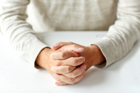 close up of senior man hands on table