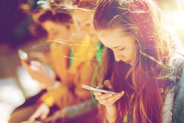 happy teenage friends with smartphones outdoors - Stock Photo - Images
