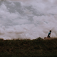 Boy Running on a Grassy Hill - PhotoDune Item for Sale