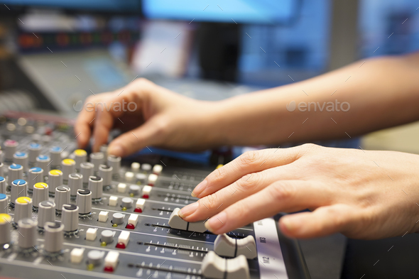 Female Radio Host Using Music Mixer In Studio - Stock Photo - Images