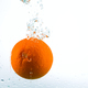 Orange in streams of water on a white background - PhotoDune Item for Sale