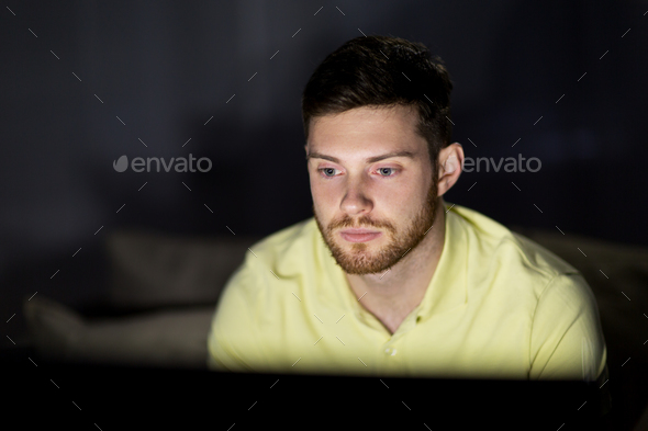 young man watching tv at night - Stock Photo - Images