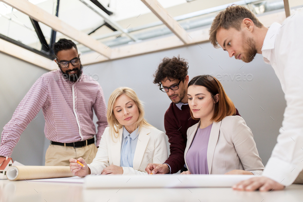 business team discussing house project at office - Stock Photo - Images