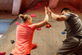man and woman exercising at indoor climbing gym