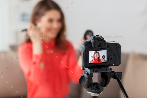 woman with bronzer and camera recording video - Stock Photo - Images