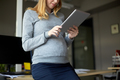 pregnant businesswoman with tablet pc at office