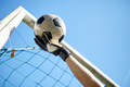 goalkeeper with ball at football goal over sky - PhotoDune Item for Sale