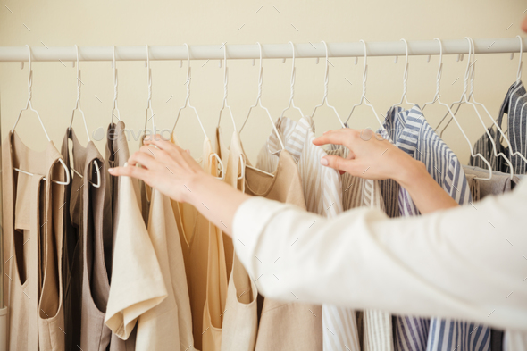 Close up of clothes hanging on rack - Stock Photo - Images