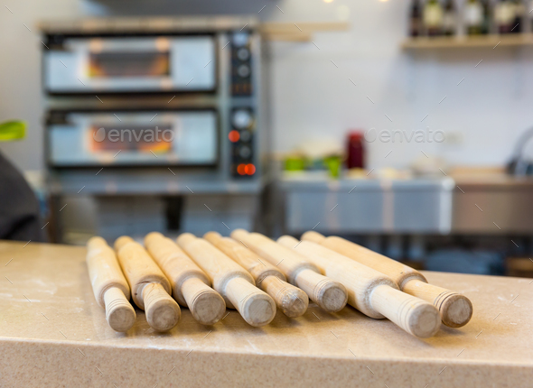 Wooden rolling pin on the table closeup - Stock Photo - Images