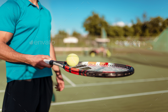 Male tennis player hand with racket and ball - Stock Photo - Images
