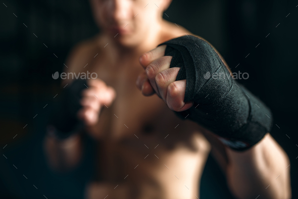 Muscular male person in black bandages - Stock Photo - Images
