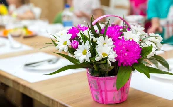 Fresh flower bouquet decorated with basket - Stock Photo - Images