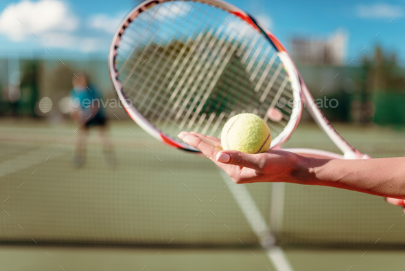 Female hands with ball and tennis racket - Stock Photo - Images