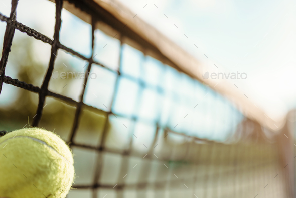 Ball in net closeup, big tennis concept - Stock Photo - Images