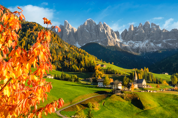 Village in a Dolomite landscape in autumn - Stock Photo - Images