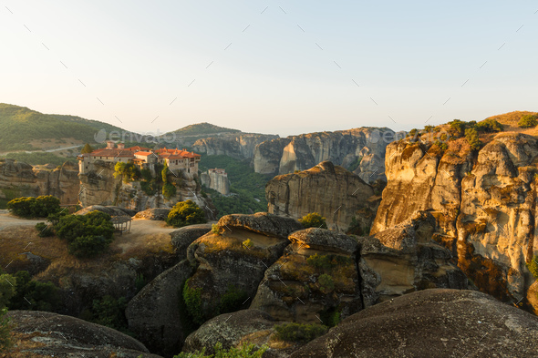 First sun rays on the Holy Monastery of Varlaam on the edge of high rock. Kalambaka, Greece - Stock Photo - Images