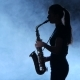 Silhouette Professional Musician Female Playing on Saxophone. Smoky Isolated Studio