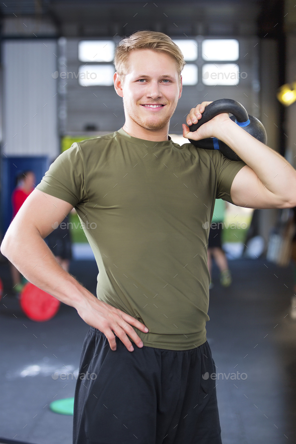 Confident Fit Male Athlete Holding Kettlebell In Health Club - Stock Photo - Images