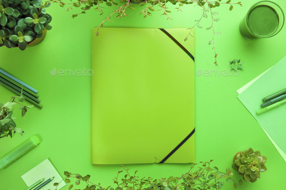 Green Concept of a Folder And Office Supplies On Desk - Stock Photo - Images