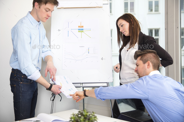 Business People Discussing Over Document In Office - Stock Photo - Images