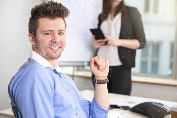 Confident Businessman Smiling While Colleague Holding Tablet Com - Stock Photo - Images