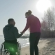 Disabled and Girl Raise Their Hands To Top, Handicapped Person Gives - VideoHive Item for Sale