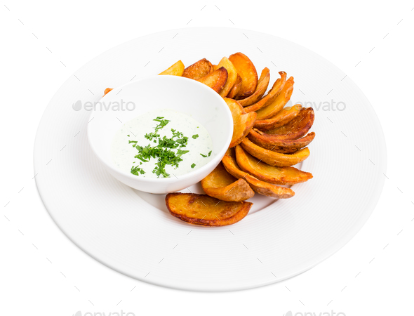 Roast potato wedges with tartar sauce. - Stock Photo - Images