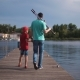 Man with Son Walking on Pier