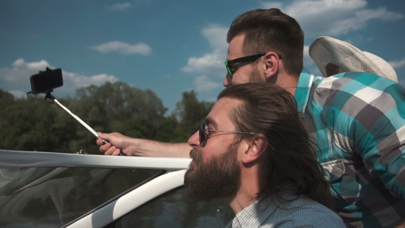 VideoHive Man on Boat with Friends Taking Selfie 20184673