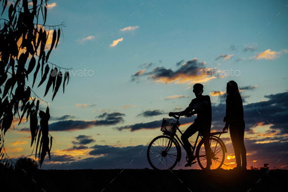 Young and girl at sunset - Stock Photo - Images