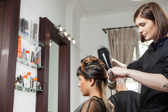 Gorgeous woman at hairdresser getting a new hairstyle - Stock Photo - Images