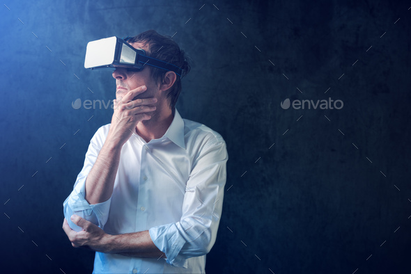 Businessman with VR goggles headset - Stock Photo - Images