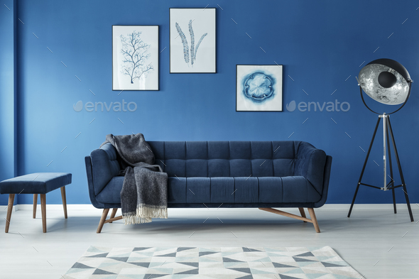 Sofa, lamp and footstool in room - Stock Photo - Images