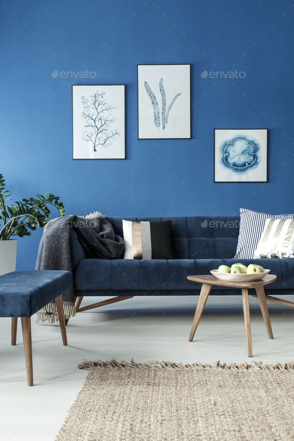 Sofa and end table in blue room - Stock Photo - Images