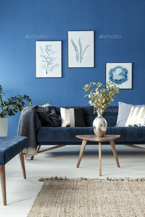 End table and sofa in room - Stock Photo - Images