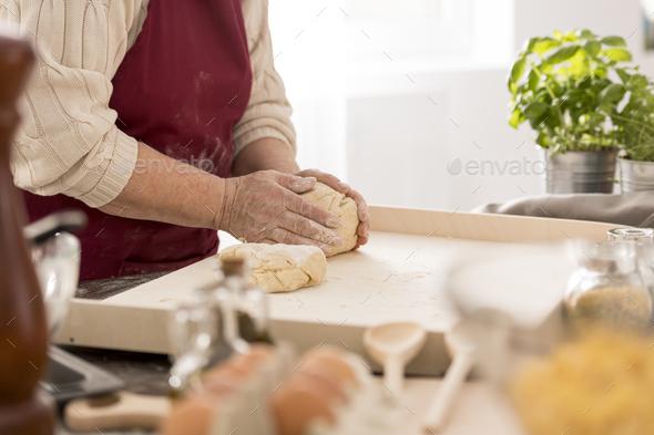 Senior woman preparing fresh pasta - Stock Photo - Images